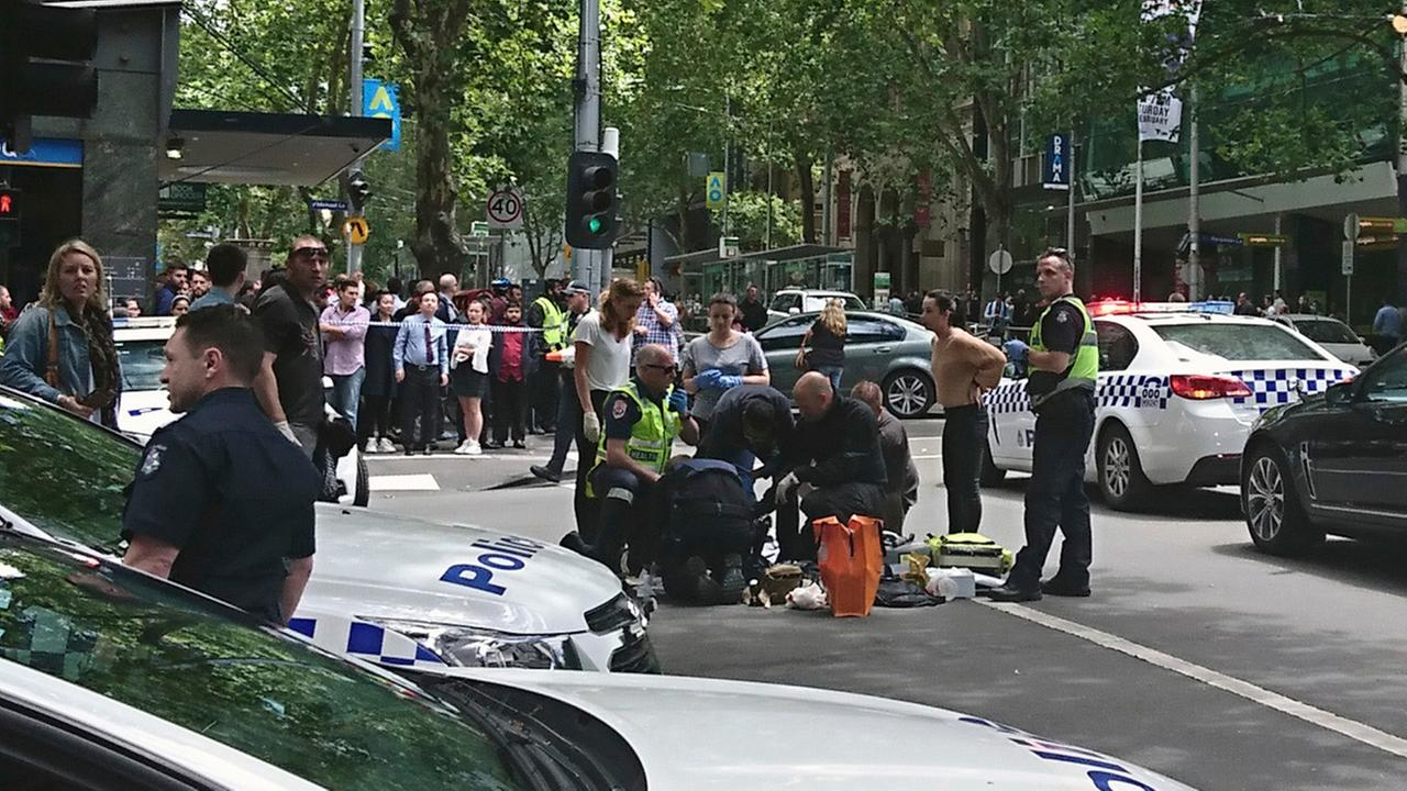 Police and emergency services gather at the scene after a car is believed to have hit pedestrians in Bourke Street Mall in Melbourne, Australia, Friday, Jan. 20, 2017.