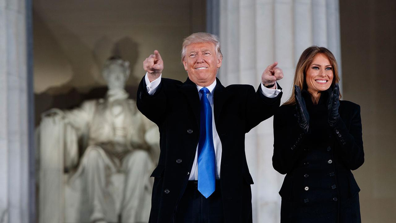 Donald Trump, left, and his wife Melania Trump arrive to the Make America Great Again Welcome Concert at the Lincoln Memorial, Thursday, Jan. 19, 2017, in Washington.