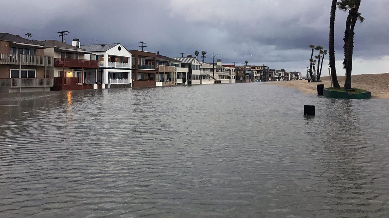 Intense flooding hits Seal Way just south of the Seal Beach pier on Monday, Jan. 23, 2017.