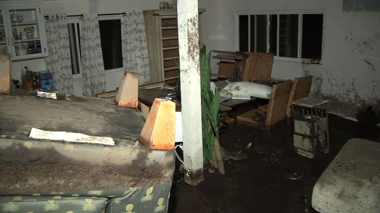 Mud cakes the inside of a home, making it unlivable for the Goertz family in Santa Clarita.