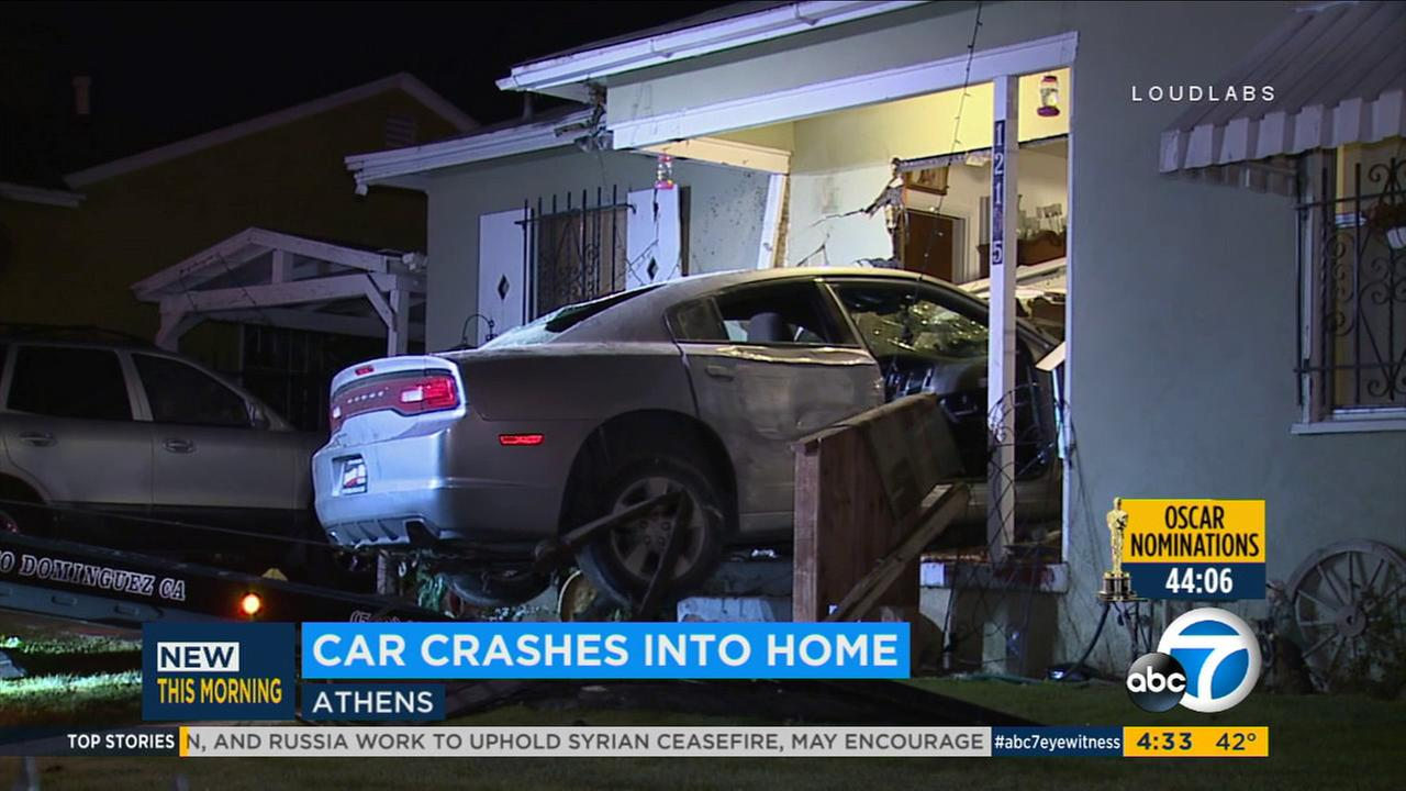 A car is seen after it slammed into a home in South Los Angeles on Monday, Jan. 23, 2017.
