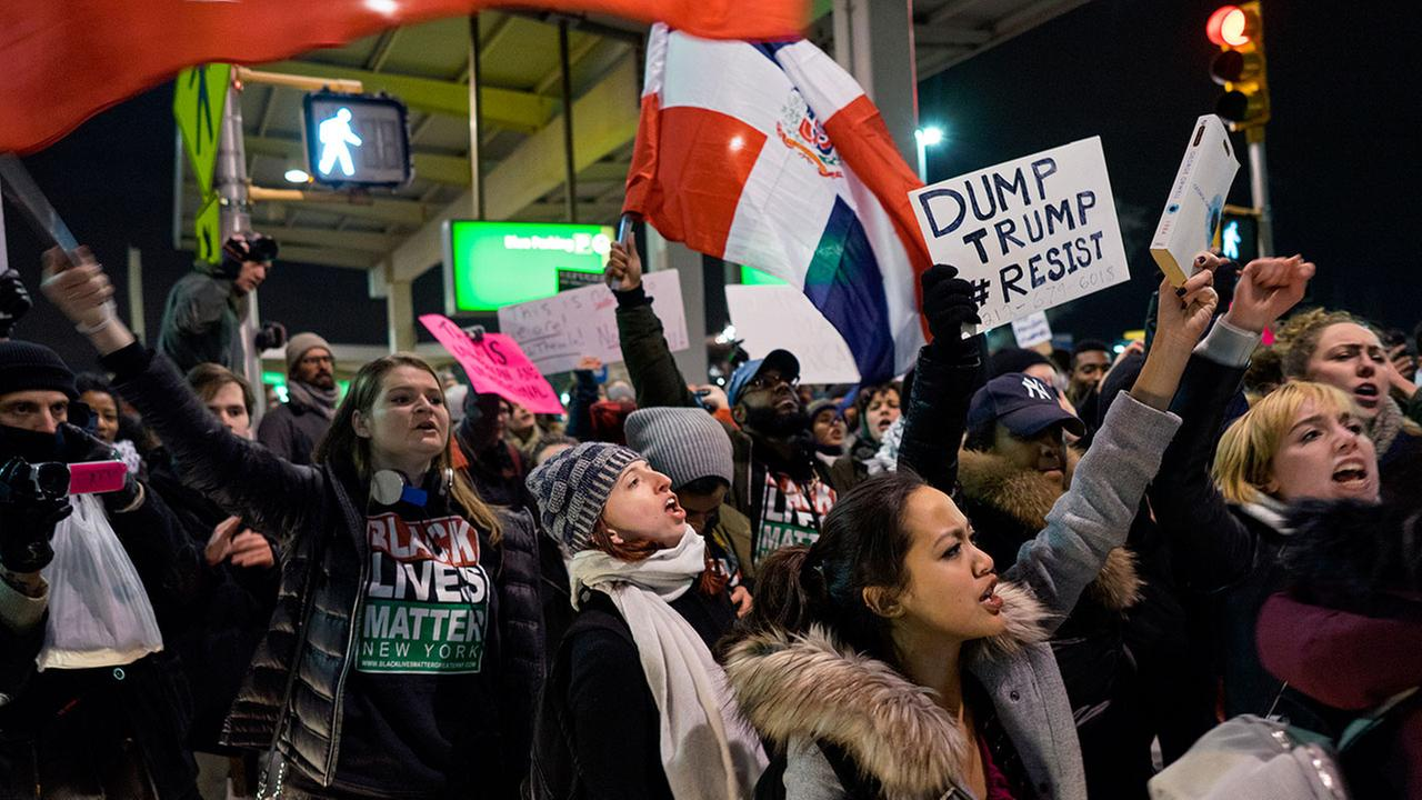 Protesters block an intersection at New Yorks JFK airport after President Donald Trump signed an order temporarily suspending immigration from countries with terrorism concerns.