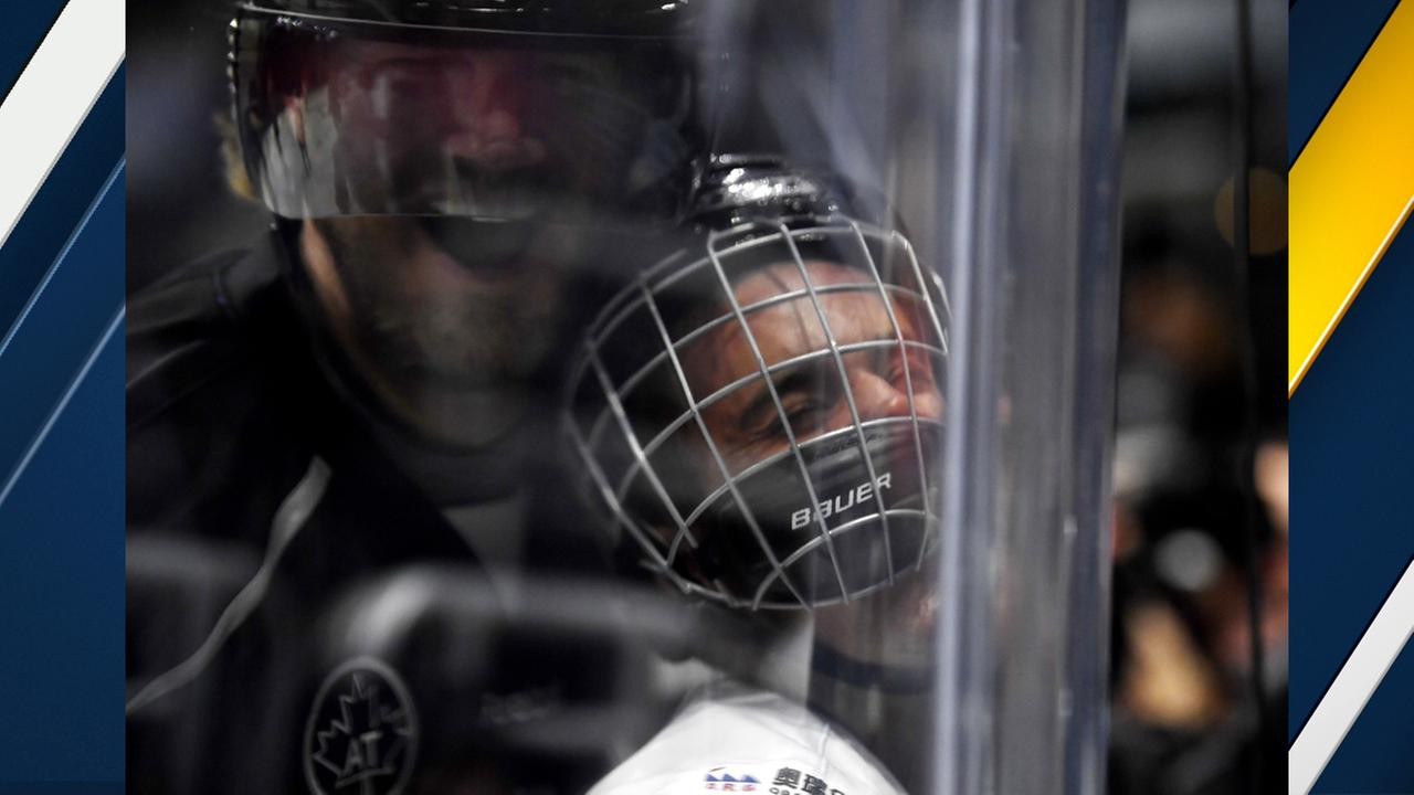 Justin Bieber is pushed into the glass by Chris Pronger during the first period of the NHL All-Star Celebrity Shootout at Staples Center, Saturday, Jan. 28, 2017, in Los Angeles.