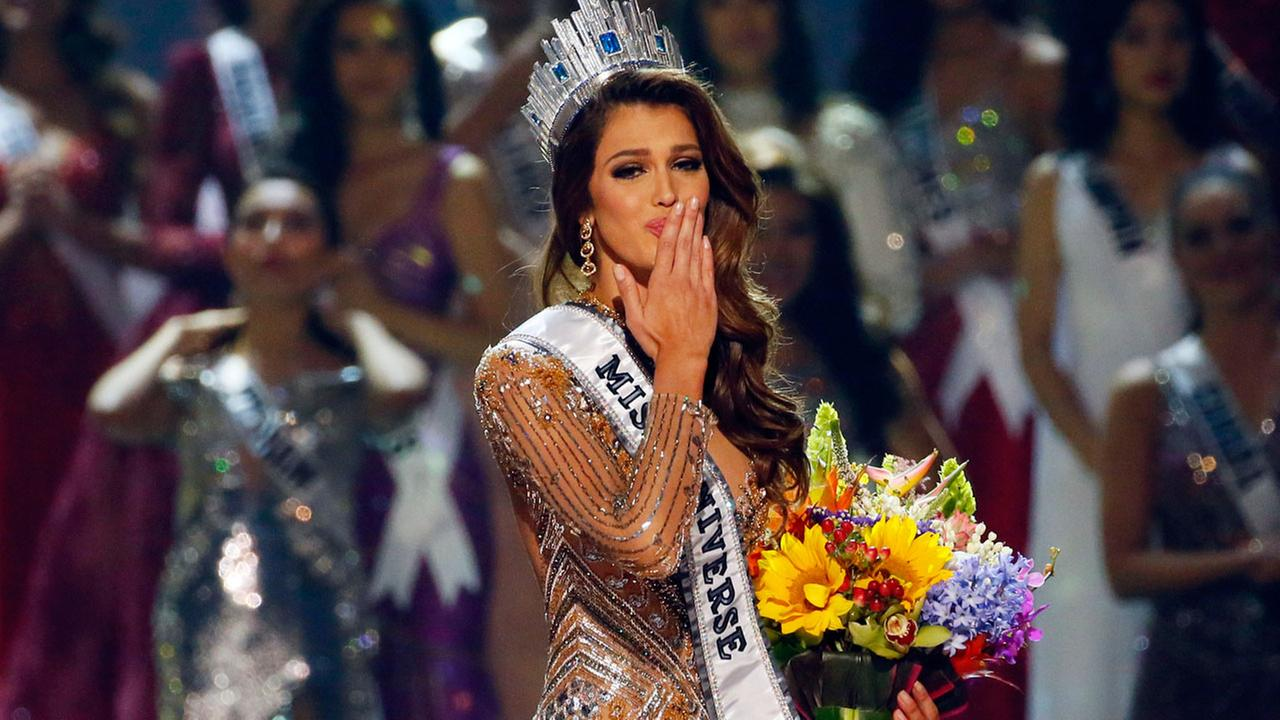 Iris Mittenaere of France blows kisses to the crowd after being proclaimed the Miss Universe 2016 in coronation Monday, Jan. 30, 2017.
