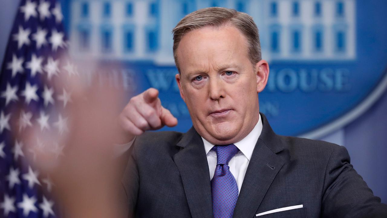 White House press secretary Sean Spicer points to a reporter to take a question during the daily news briefing at the White House in Washington, Monday, Jan. 30, 2017.