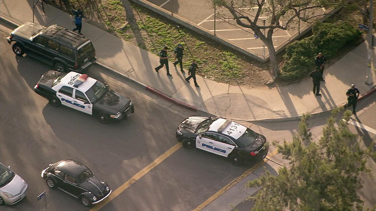 Police officers are seen outside Crenshaw High School in South Los Angeles after a reported shooting on Tuesday, Jan. 31, 2017.