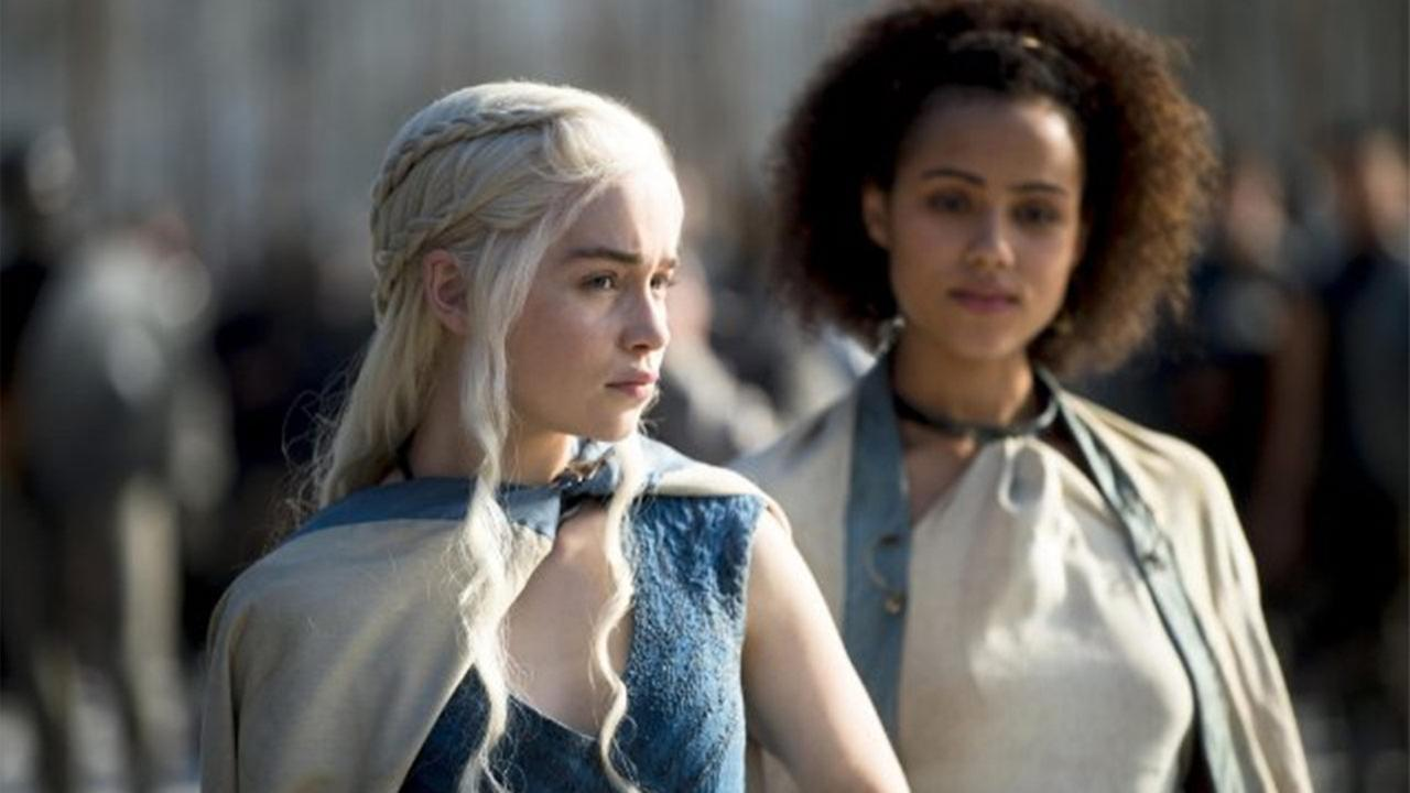 Emilia Clarke (left) and Nathalie Emmanuel (right) appear in a scene from Game of Thrones.