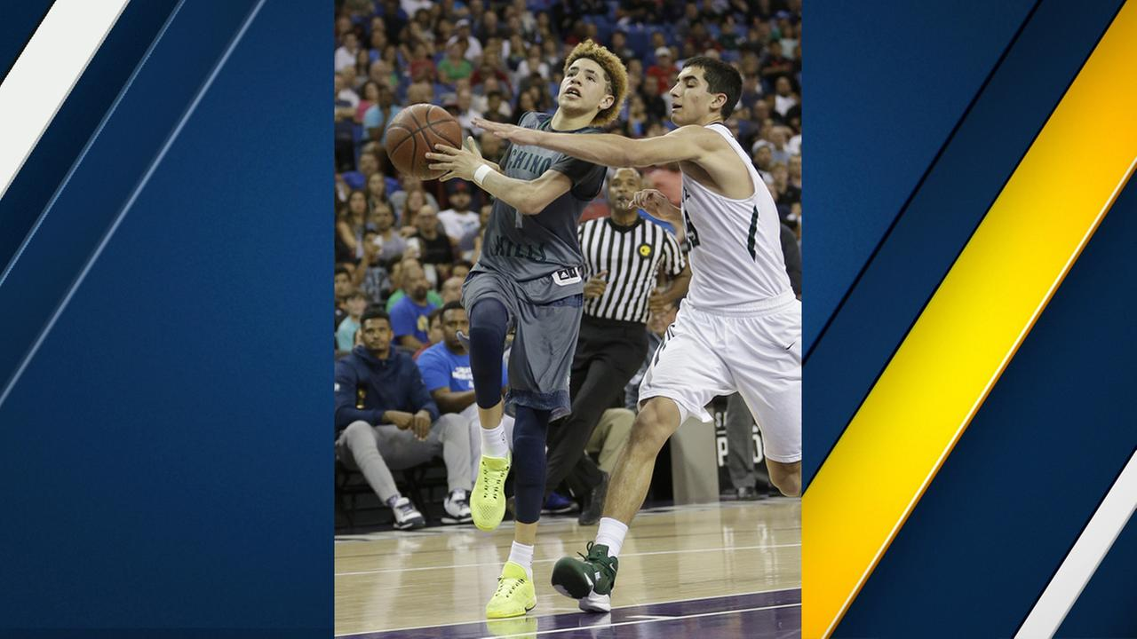 Chino Hills Lamelo Ball, left, goes to the basket during the second half of the CIF boys Open Division high school basketball championship game Saturday, March 26, 2016.