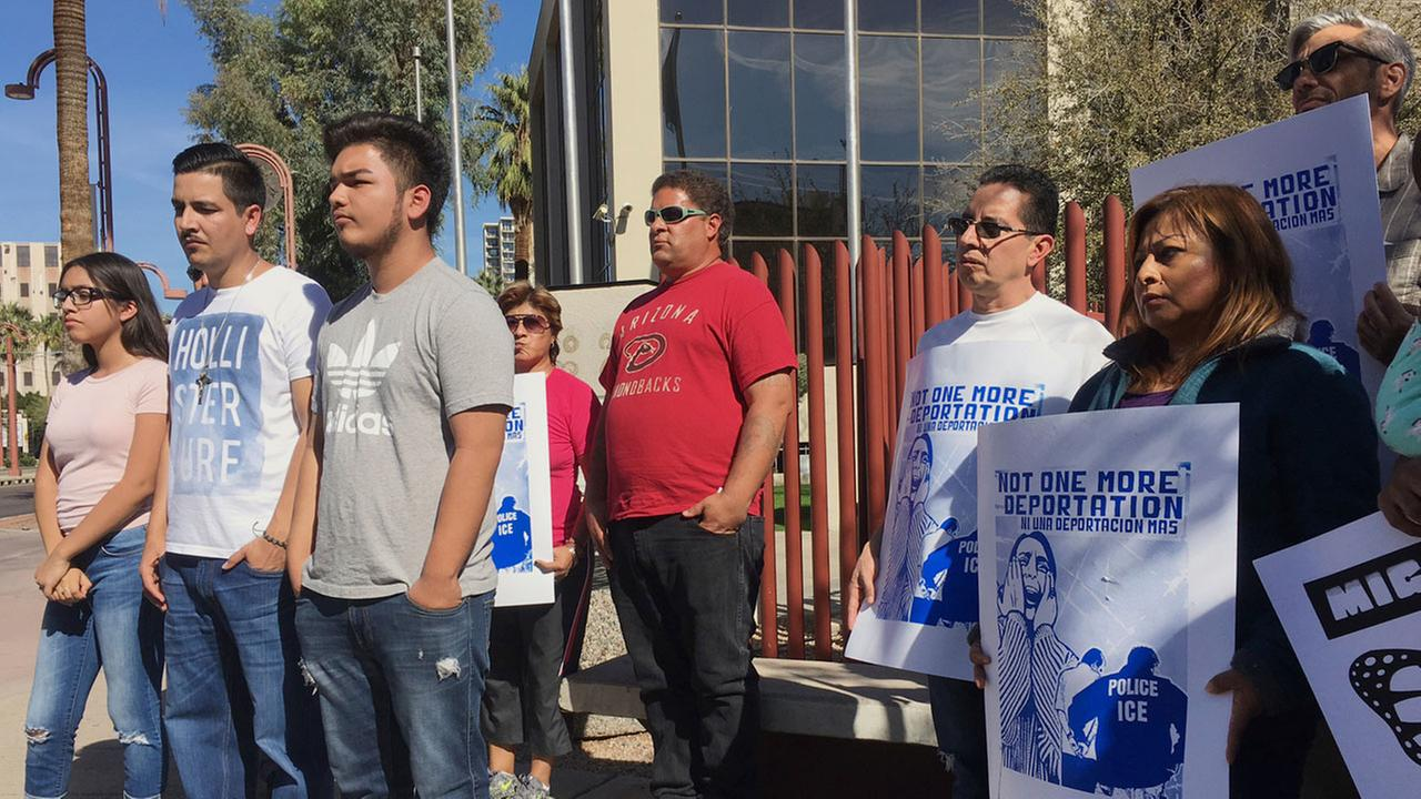Members of the family of Guadalupe Garcia de Rayos, left, stand with supporters at a news conference in front of the U.S. Immigration and Customs Enforcement office in Phoenix.