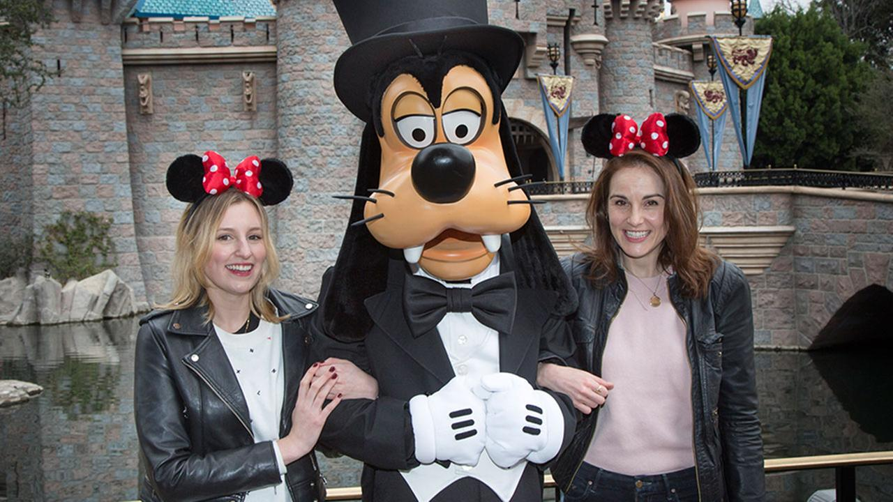 Downton Abbey stars Michelle Dockery and Laura Carmichael meet Goofy at Sleeping Beauty Castle at Disneyland park in Anaheim, Calif., on Friday, Feb. 10, 2017.