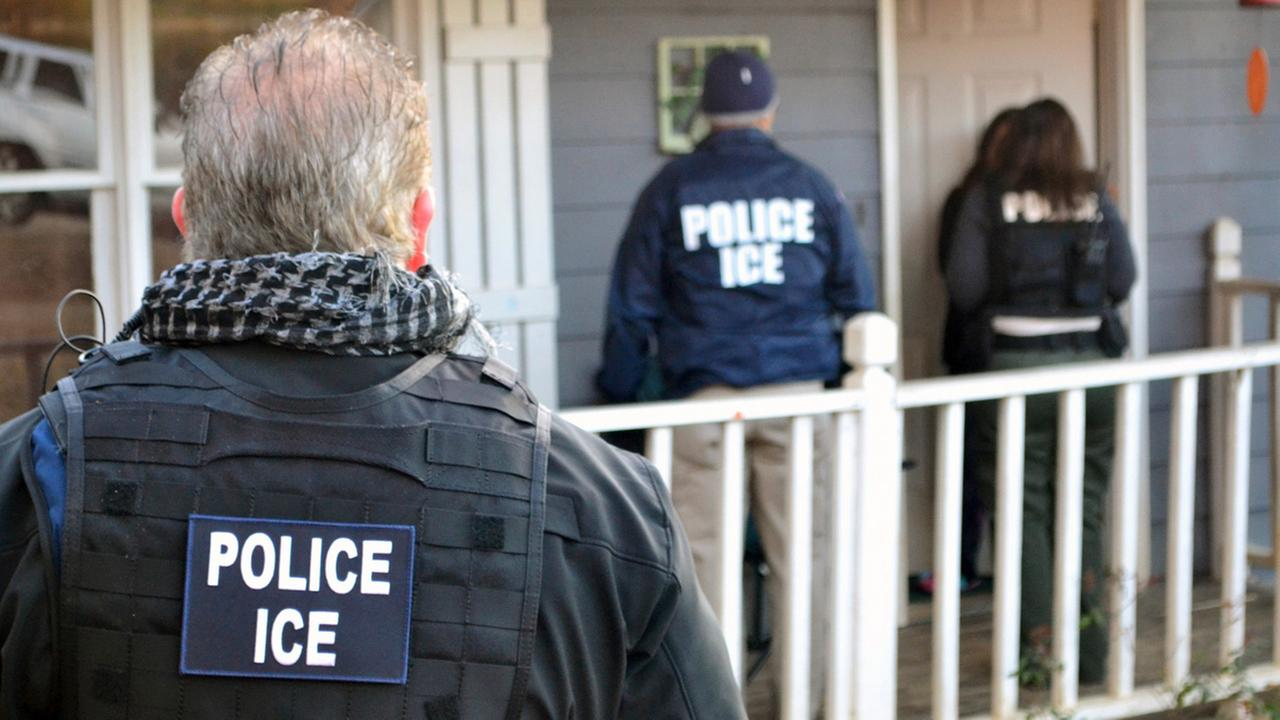 In this Feb. 9, 2017, photo provided U.S. Immigration and Customs Enforcement, ICE agents are seen at a home in Atlanta during a targeted enforcement operation.