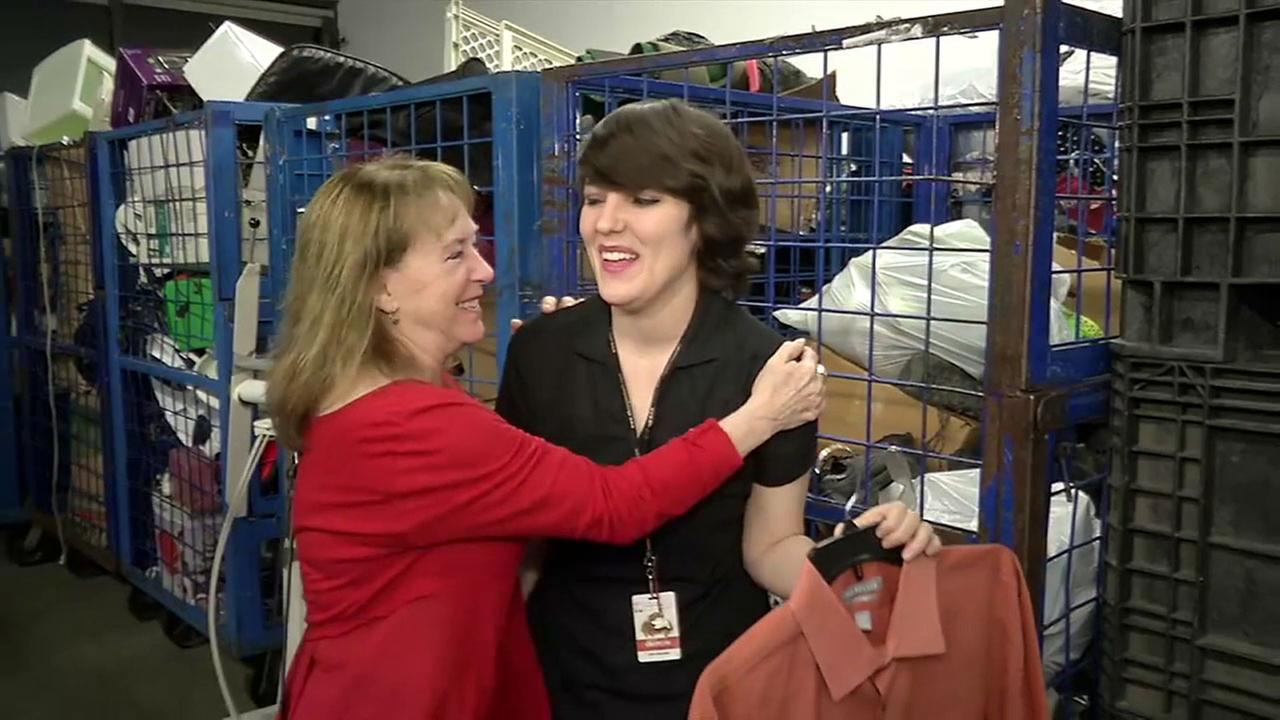 Linda Hoffman (left) thanks Goodwill employee Caitlin Mulvihill who found her husbands shirt with his $8,000 vacation stash.