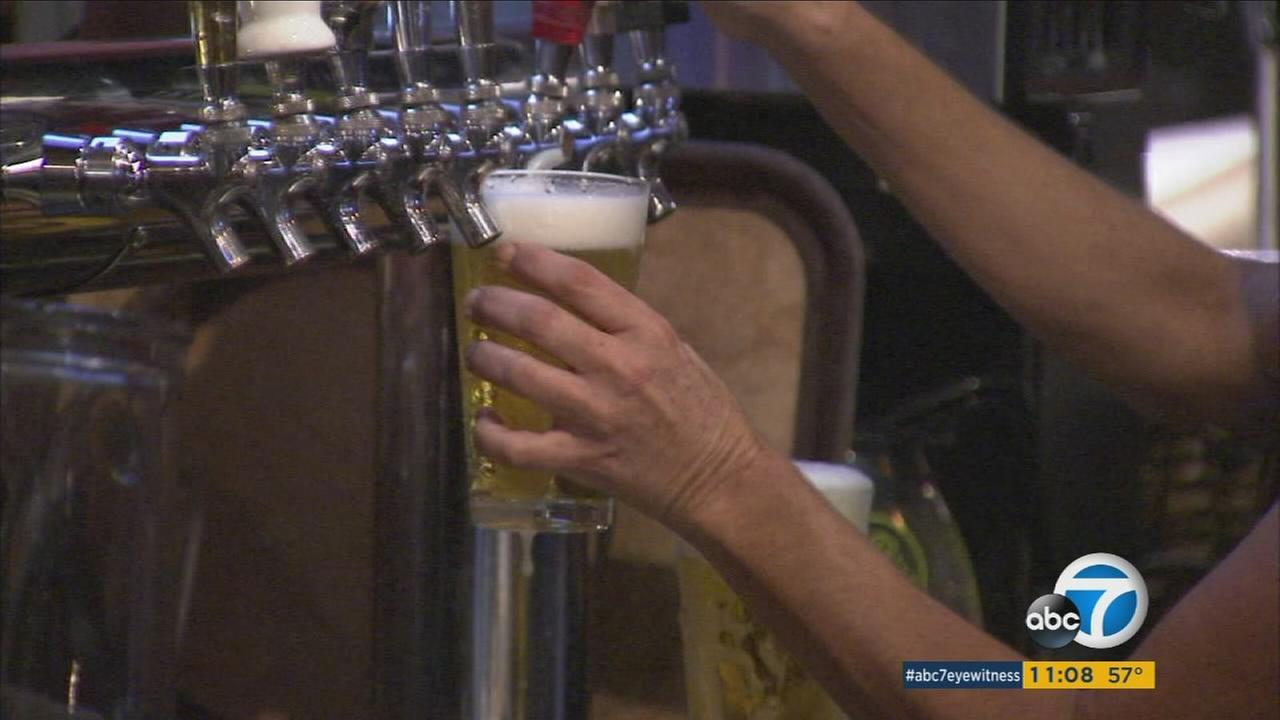 Beer is poured from a tap in this undated file photo.