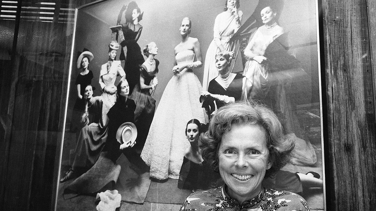 Eileen Ford poses in front of a picture of her successful models, Oct. 29, 1977, New York.