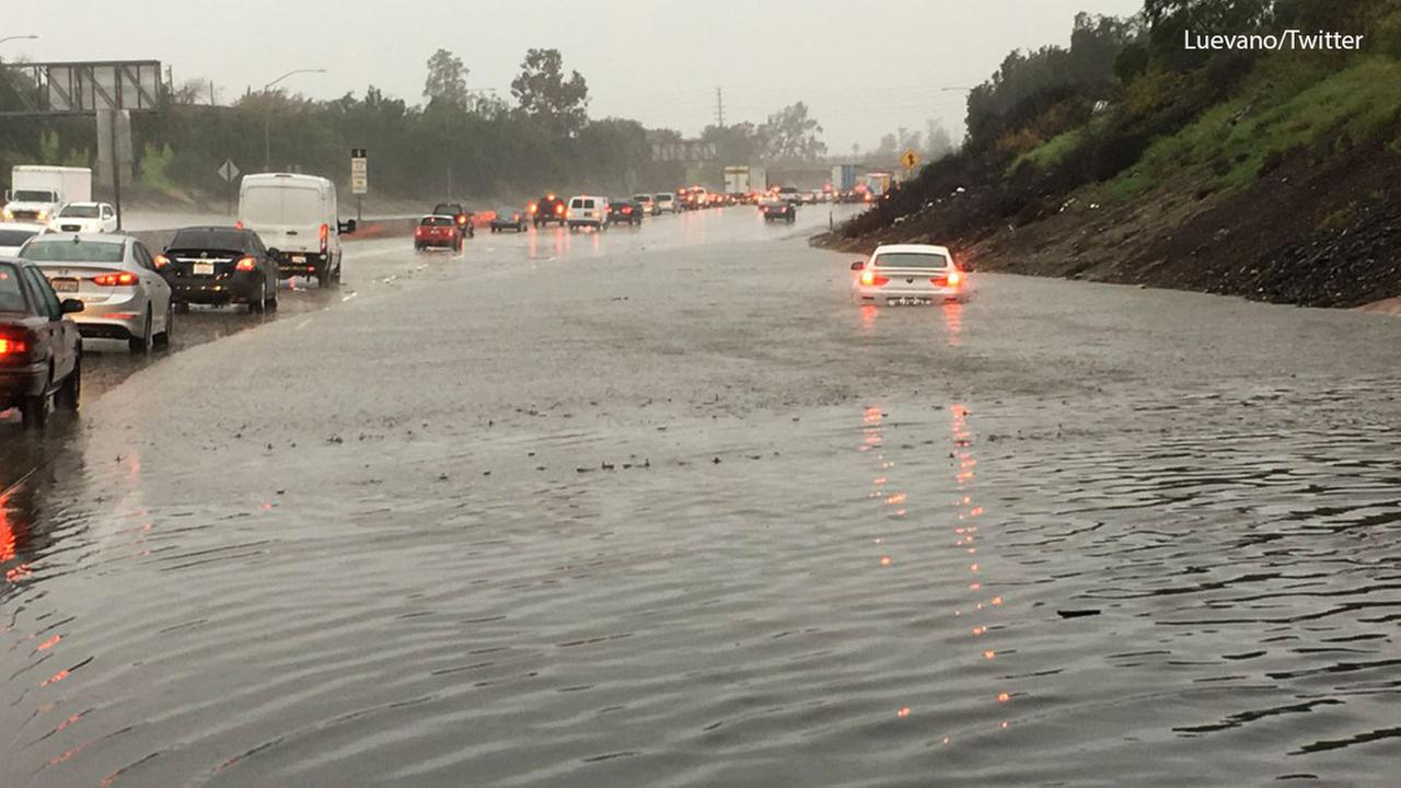 A BMW is halfway submerged in floodwaters on the northbound 5 Freeway at Lankershim Boulevard in Sun Valley on Friday, Feb. 17, 2017.Luevano/Twitter