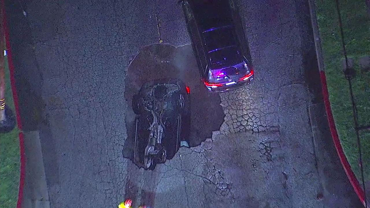 A car plunged into a sinkhole in Studio City Friday, Feb. 17, 2017.