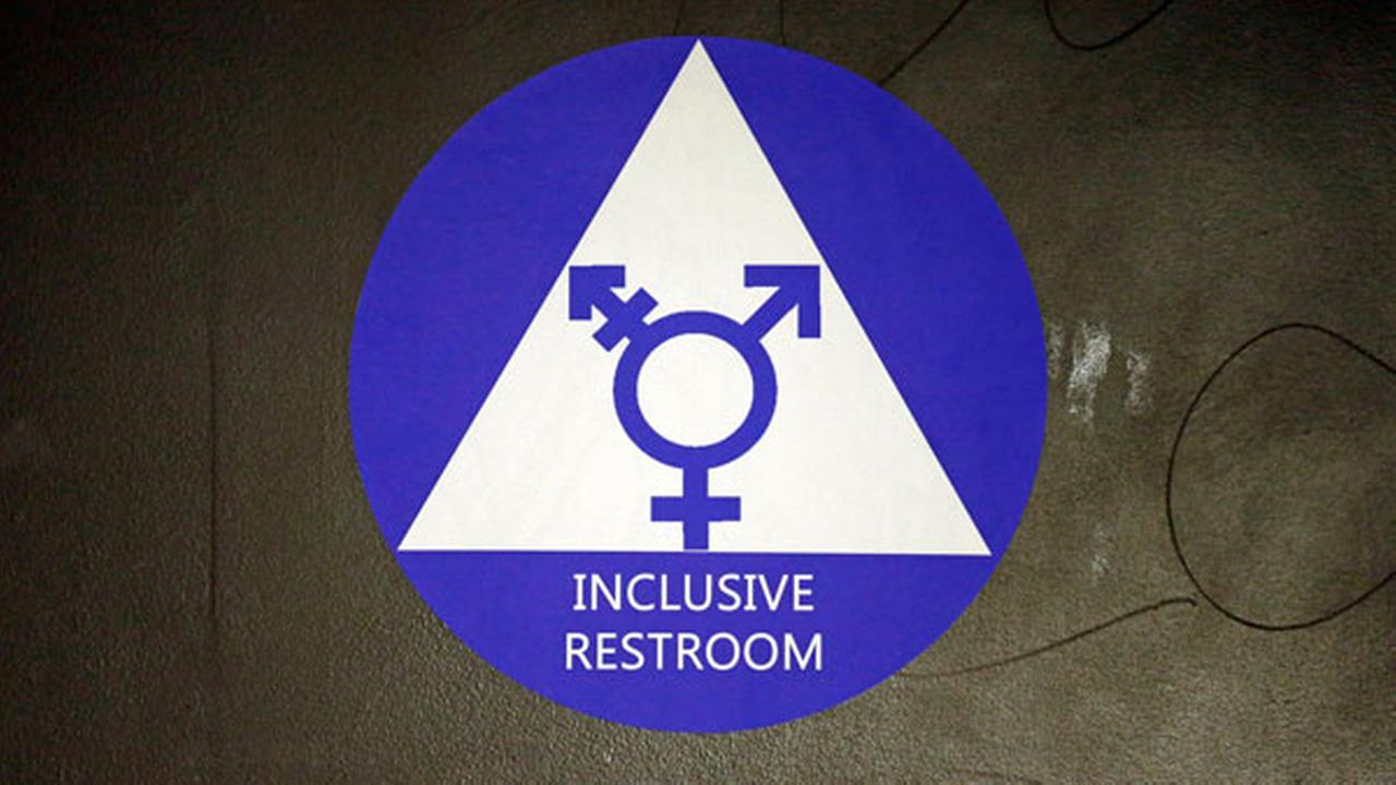 FILE - In this May 17, 2016, file photo, a new sticker designates a gender neutral bathroom at Nathan Hale high school in Seattle.