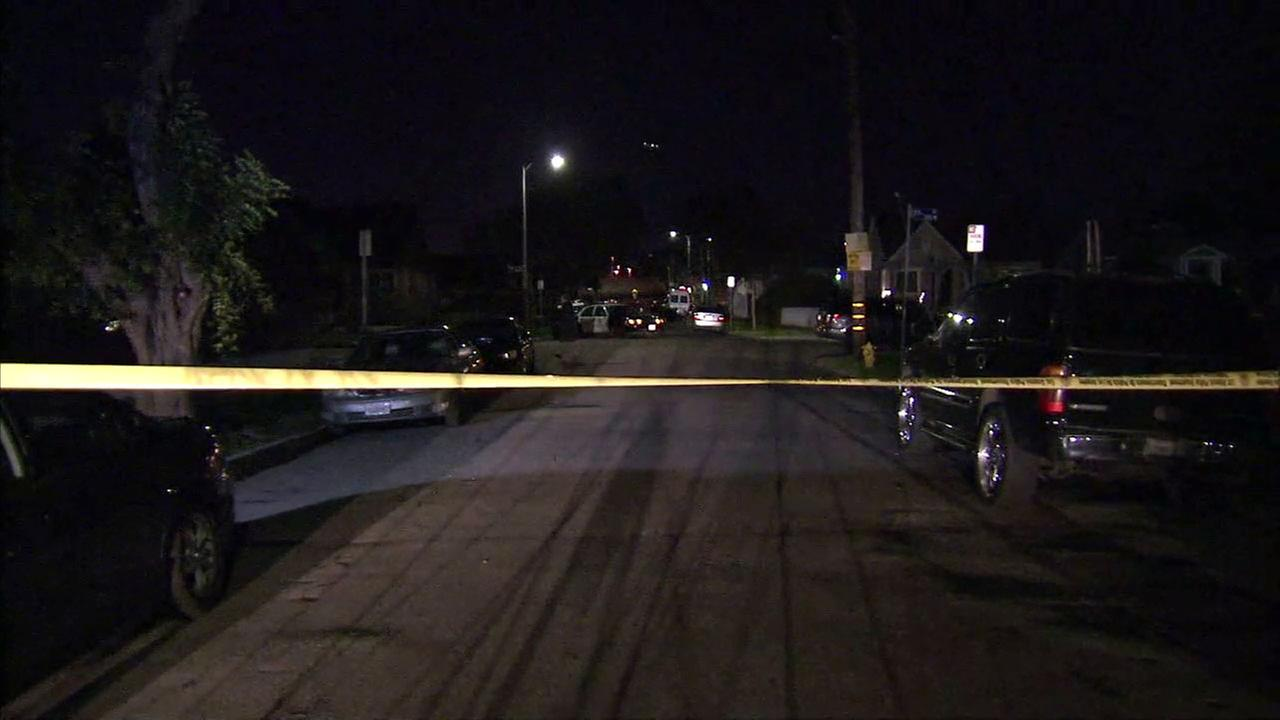 Authorities cordoned off a part of a South Los Angeles neighborhood after a pregnant woman was shot multiple times, including in the chest, on Thursday, Feb. 23, 2017.