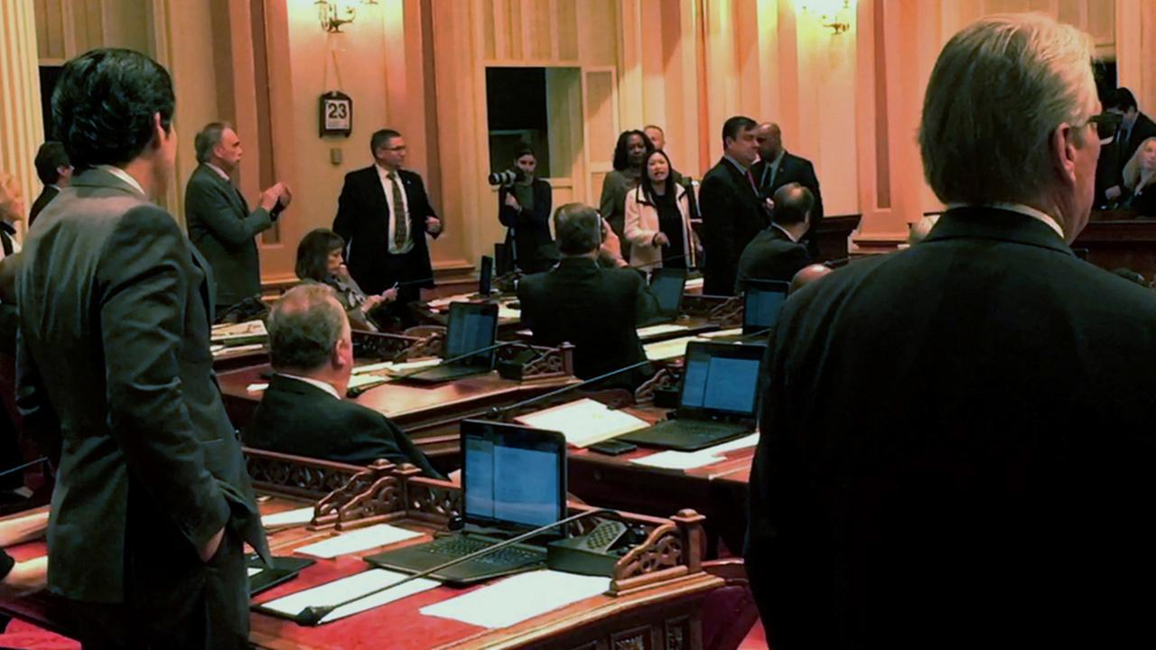 In this image made from a mobile video shows Republican Sen. Janet Nguyen being removed from the Senate floor in Sacramento, Calif., Thursday, Feb. 23, 2017.