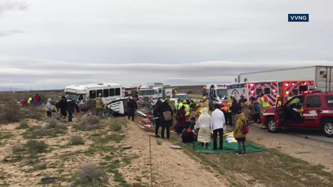 Emergency personnel help those involved in a bus crash in the Kramer Junction area in San Bernardino County on Monday, Feb. 27, 2017.