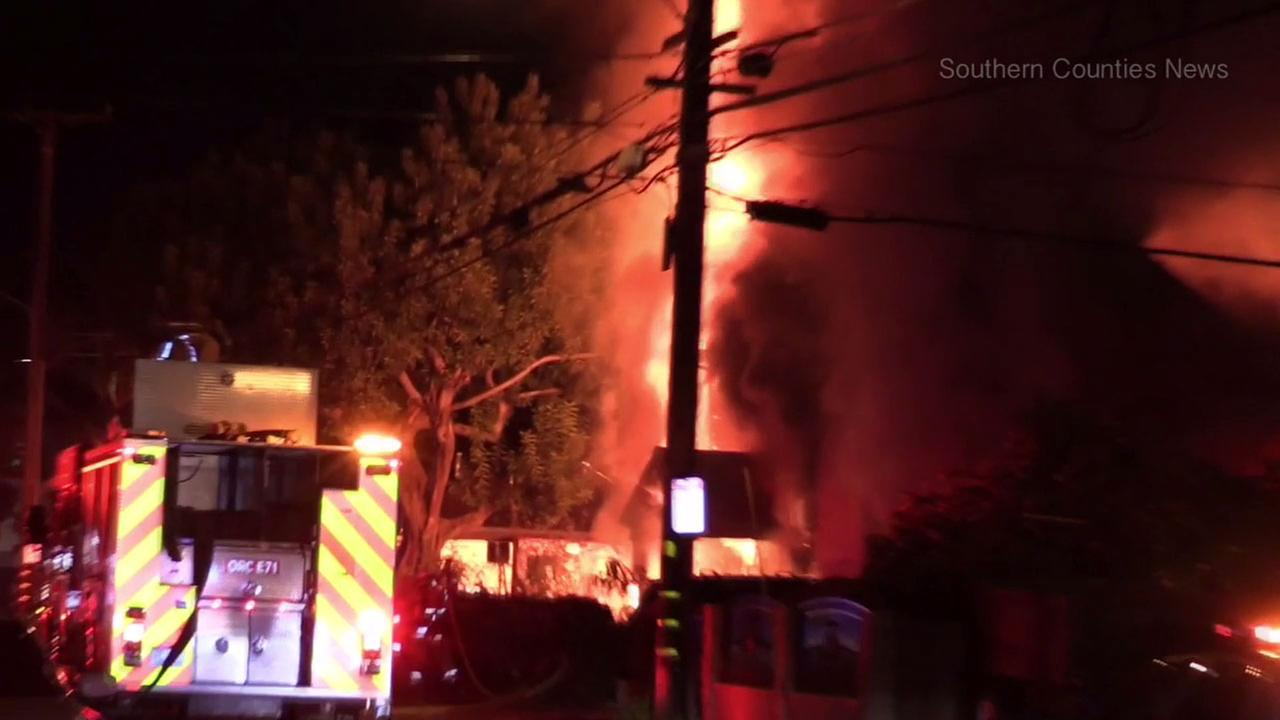 A man upset over a recent divorce burned down a house in Santa Ana Thursday night, officials said.