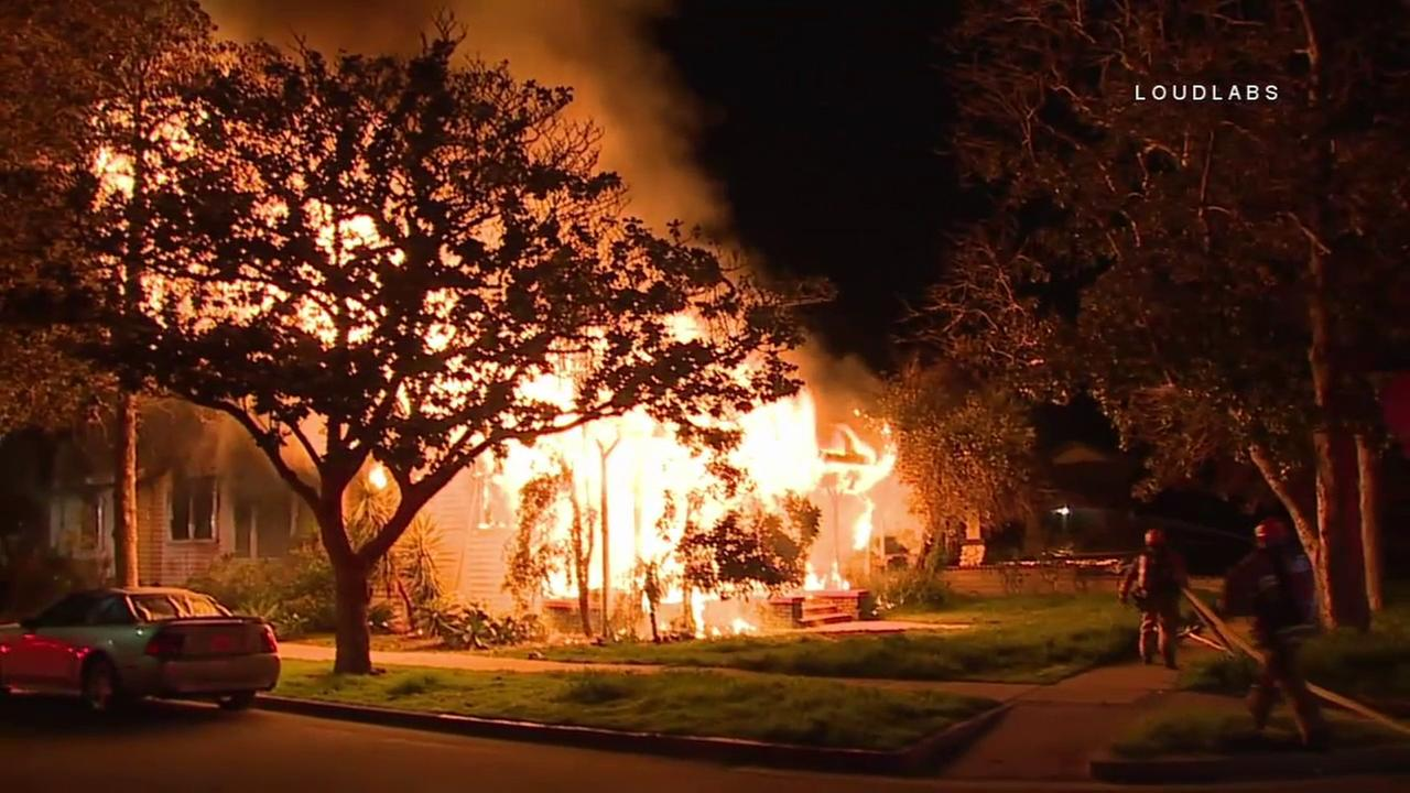 Flames engulfed a home in South Los Angeles on Friday, March 3, 2017.