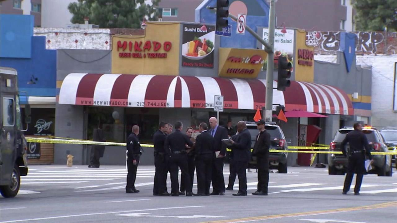 Los Angeles Police Department investigators are seen in downtown after an allegedly armed man was shot and killed on Saturday, March 4, 2017.