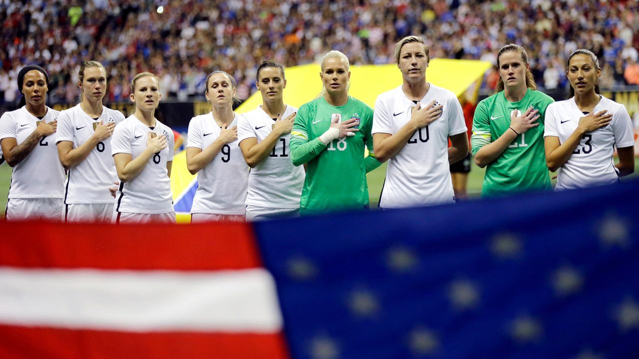 In this Dec. 10, 2015, file photo, the United States womens national team lines up for the national anthem before an international soccer match against Trinidad and Tobago.