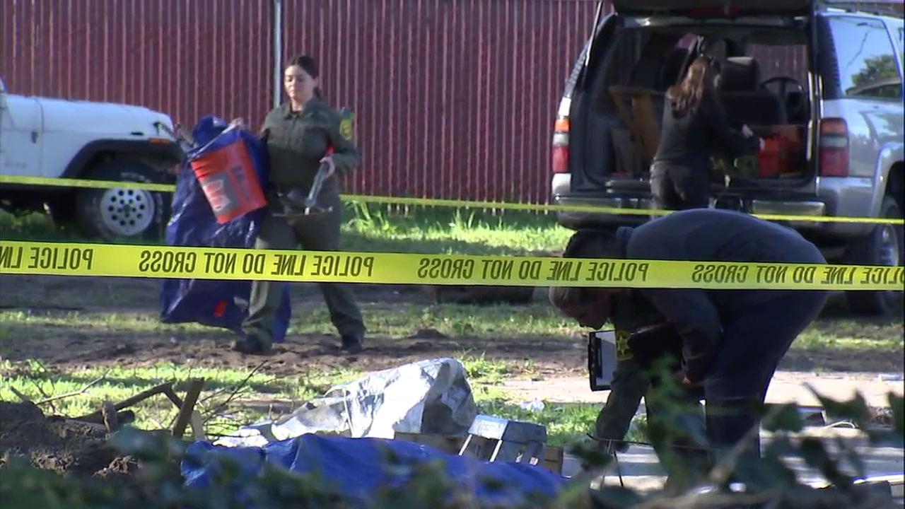 Crews help investigate human remains found in the backyard of a Buena Park home on Monday, March 6, 2017.