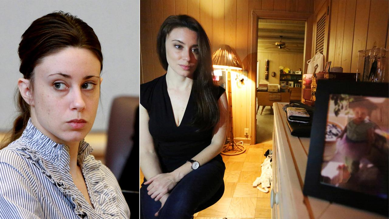 In a Feb. 13, 2017 photo, right, Casey Anthony poses for a portrait next to a photo of her daughter, Caylee, in her West Palm Beach, Fla., bedroom.