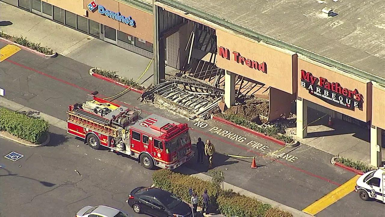 Strip mall building partially collapses in Carson