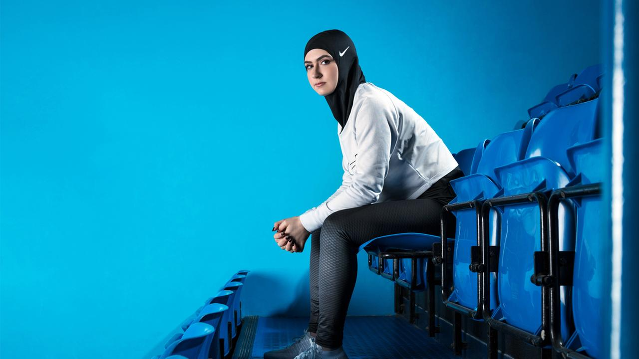 In this undated image provided by Nike, figure skater Zahra Lari model wears Nikes new hijab for Muslim female athletes.