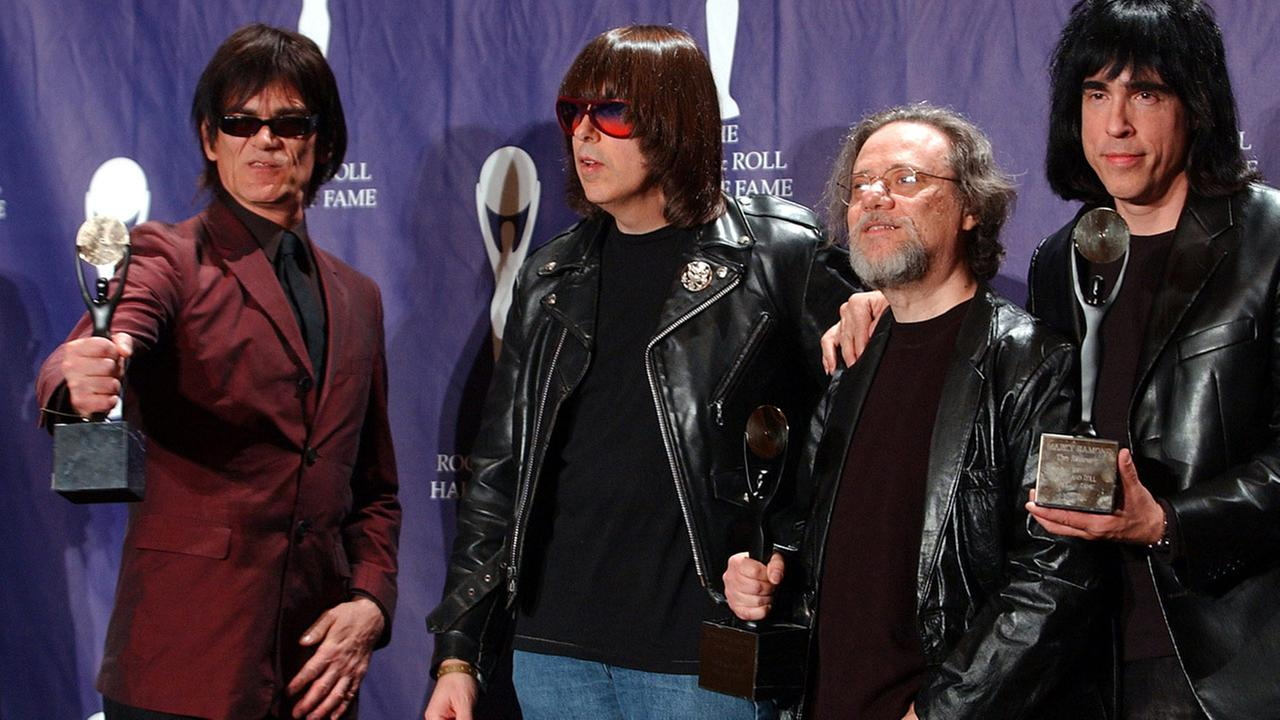 Members of the Ramones, from left to right, Dee Dee, Johnny, Tommy and Marky Ramone hold their awards after being inducted at the Rock and Roll Hall