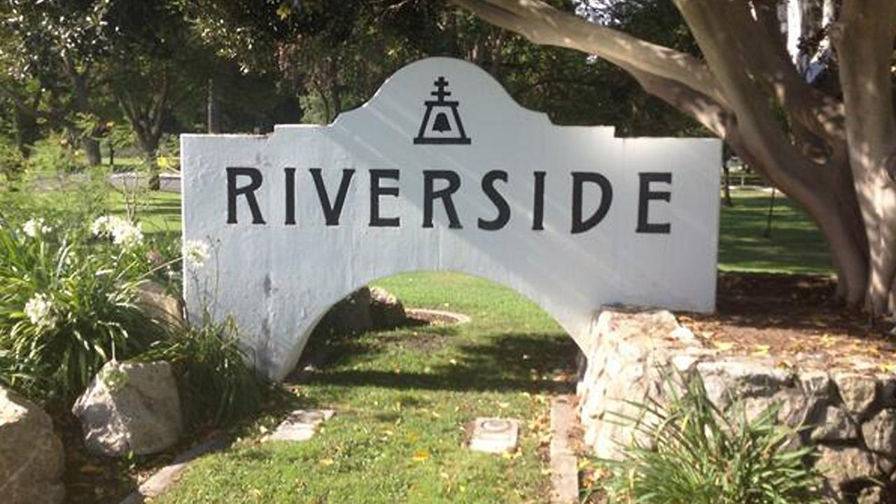 A sign for the city of Riverside is seen.