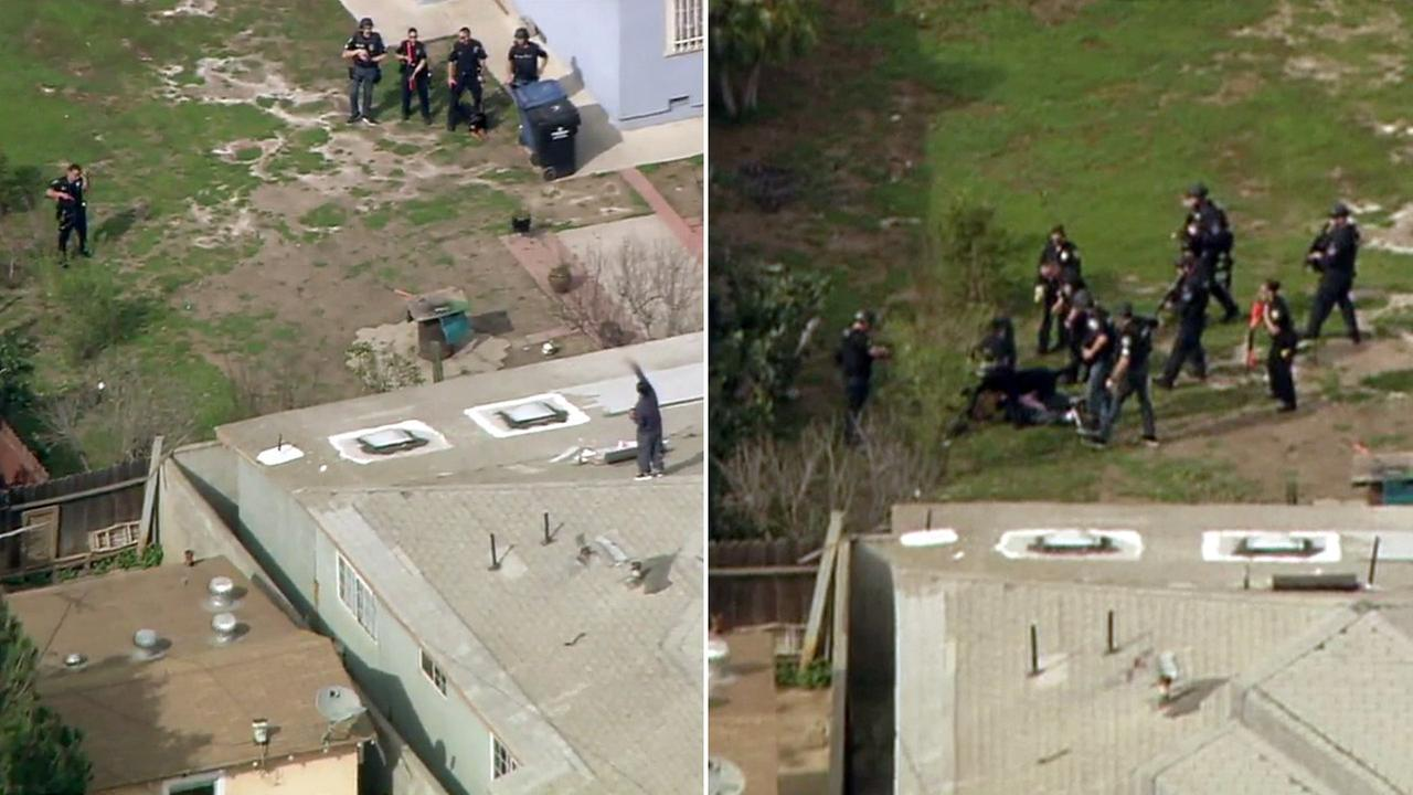 A man was taken into custody after a homicide and standoff with police on a roof in Inglewood on Friday, March 10, 2017.