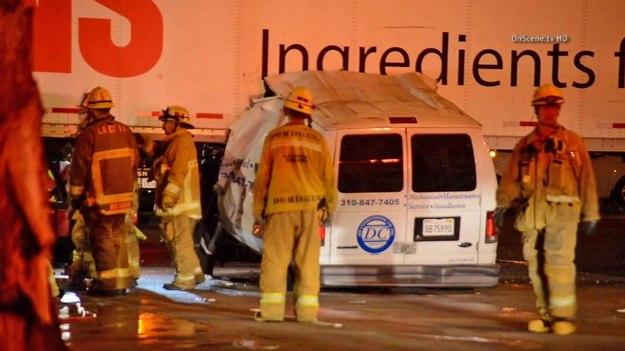 L.A. County Fire crews at the scene of a crash between a van and a big rig in Commerce on Saturday, July 12, 2014.