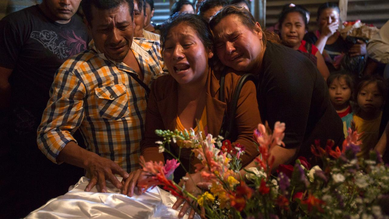Marta Lidia Garcia cries during the wake of her 17-year-old daughter Siona Hernandez, who died in a youth shelter fire, in Ciudad Peronia, Guatemala, Friday, March 10, 2017.