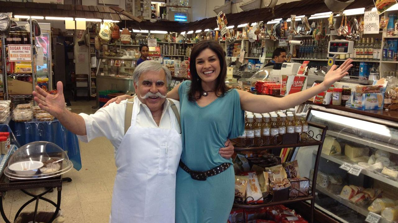 Eye on L.A. host Tina Malave is seen with Papa Cristo of Papa Cristos restaurant in L.A.