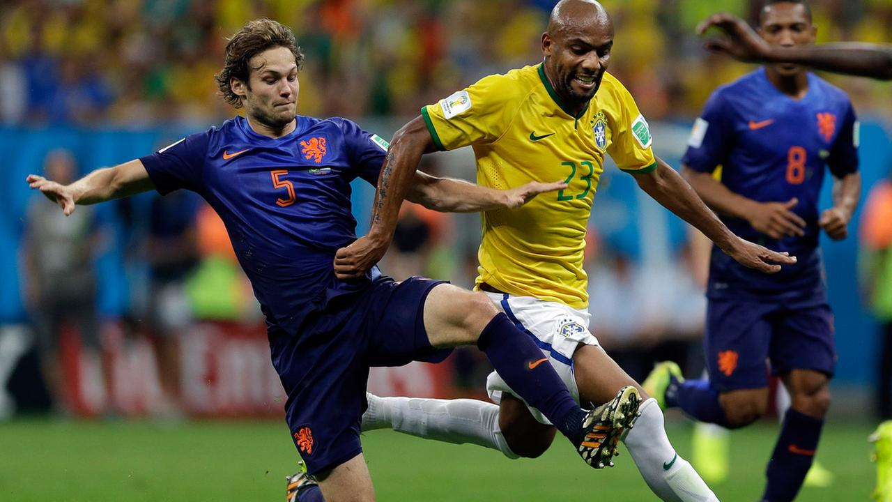 Netherlands Daley Blind, left, challenges Brazils Maicon during the World Cup third-place soccer match with Brazil.