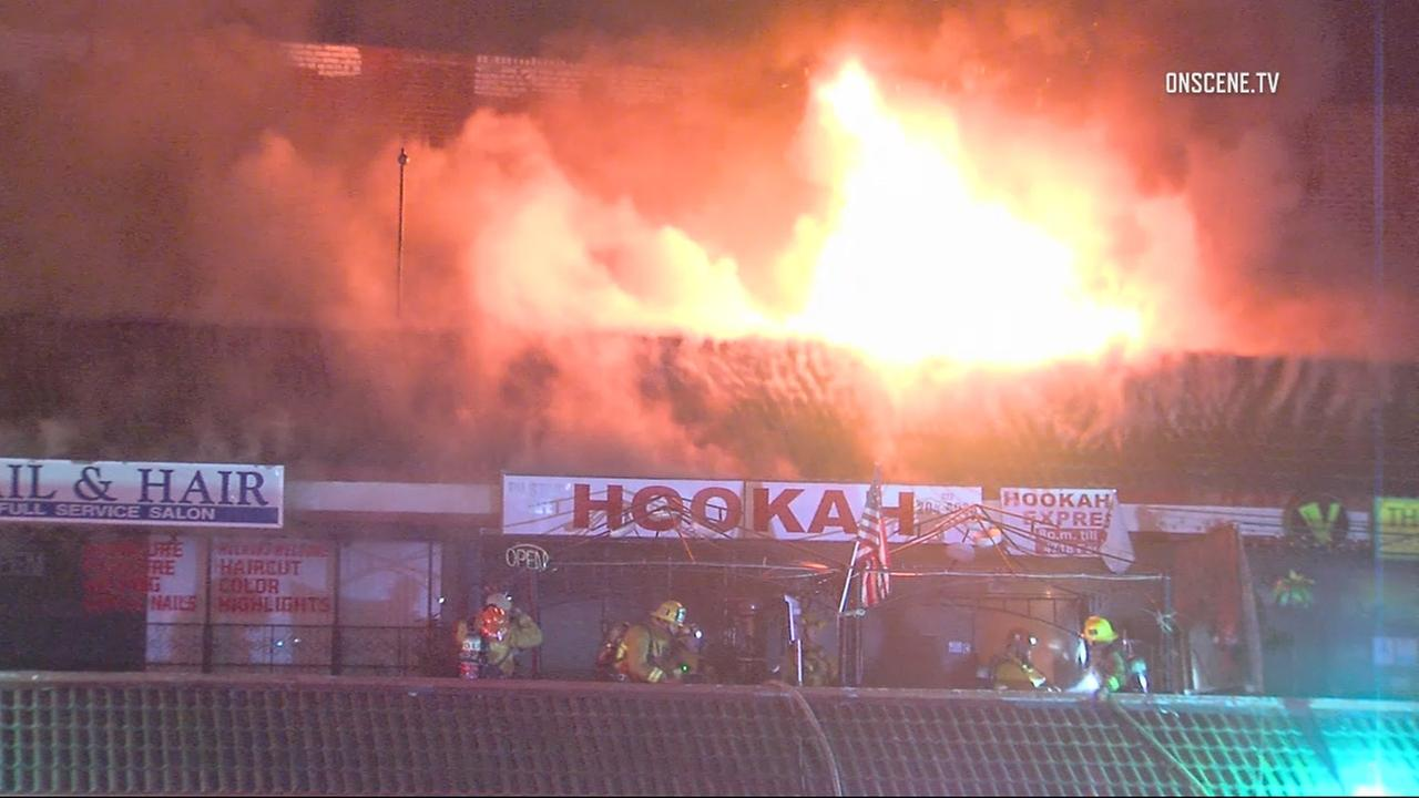 Firefighters battled dramatic flames at a strip mall in Hollywood on Tuesday, March 14, 2017.