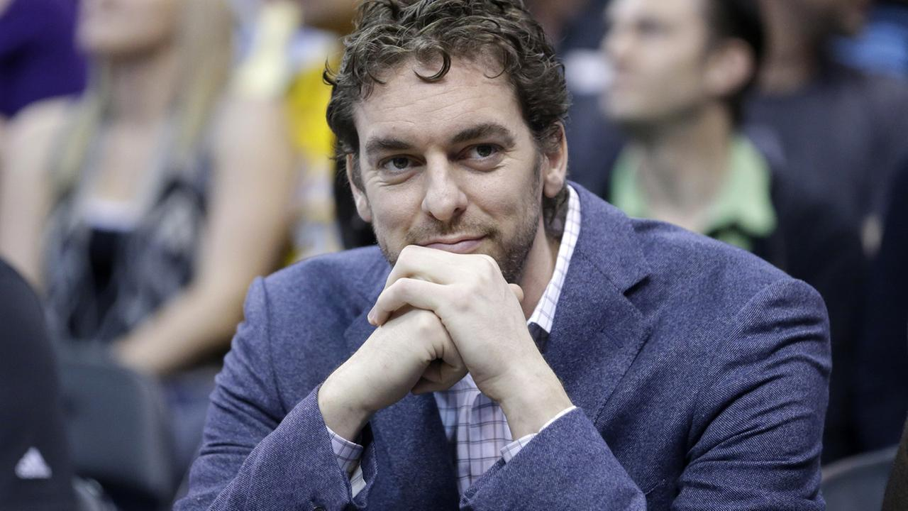 Pau Gasol looks on as he sits on the bench in the second half during an NBA basketball game Monday, April 14, 2014.