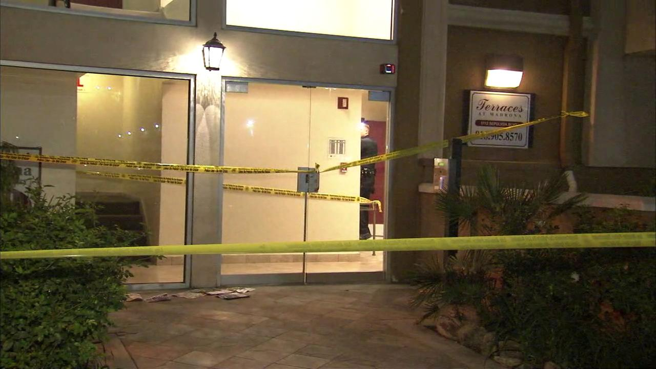 A Los Angeles Police Department stands inside the lobby of a Sherman Oaks apartment building after a man was found fatally shot on Wednesday, March 15, 2017.