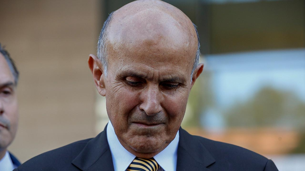 Former Los Angeles County Sheriff Lee Baca takes questions from the media as he leaves federal court in Los Angeles on Wednesday, March 15, 2017.