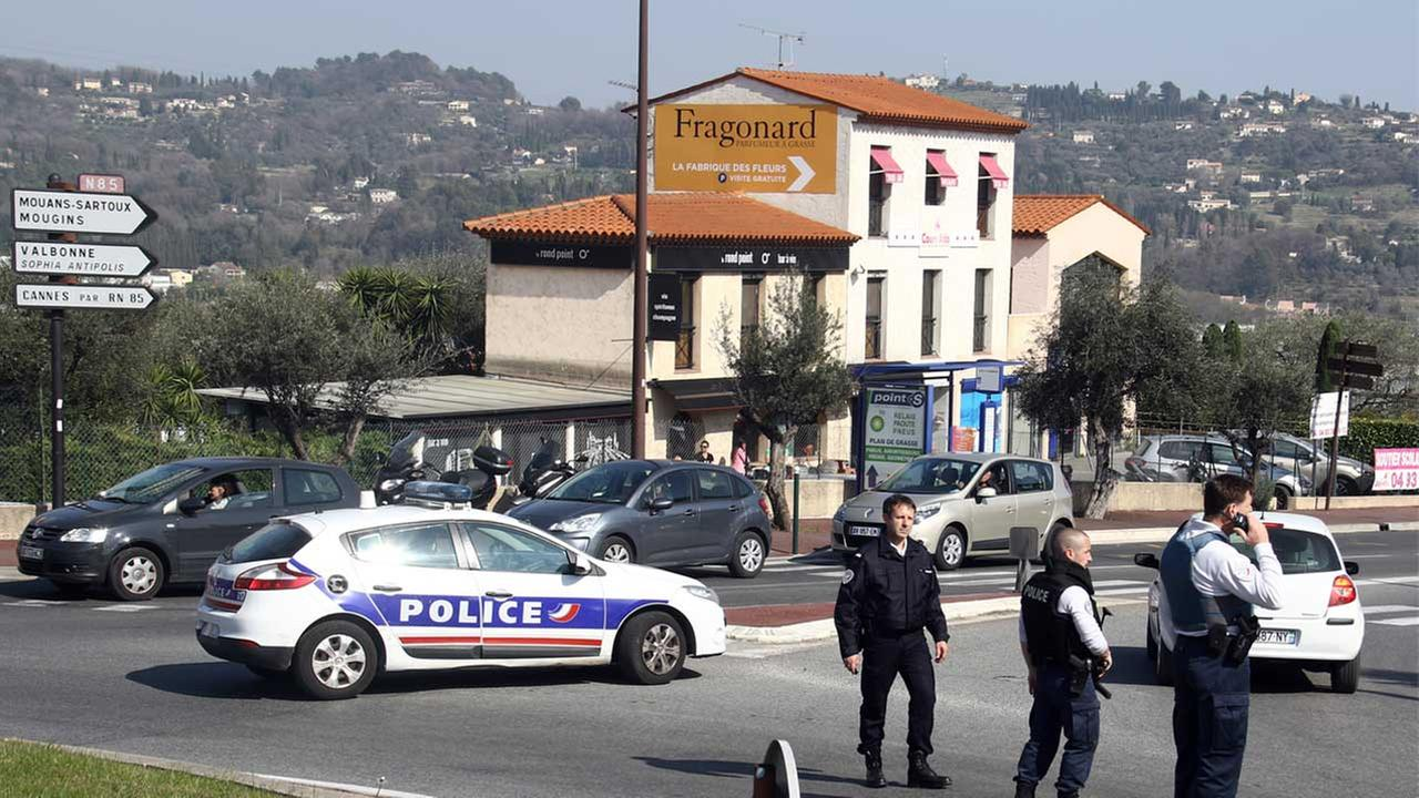 Police officers take position after an attack in a high school student in Grasse, southern France, Thursday, March 16, 2017.