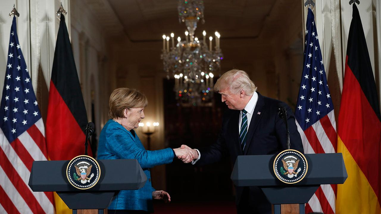 President Donald Trump and German Chancellor Angela Merkel shakes hands at a joint news conference in Washington, Friday, March 17, 2017.