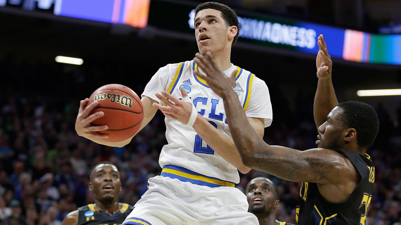UCLA guard Lonzo Ball drives to the basket against Kent State guard Deon Edwin in a first-round game of the NCAA tournament in Sacramento on Friday, March 17, 2017.