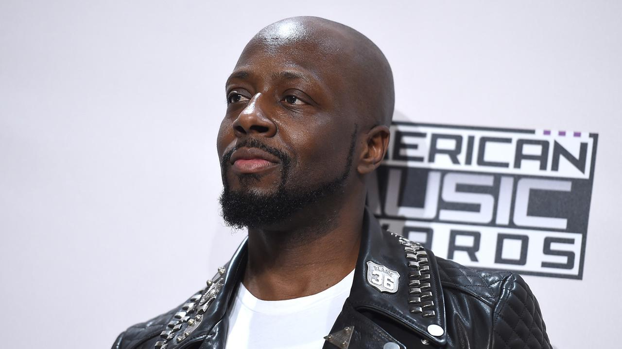 Wyclef Jean arrives at the 42nd annual American Music Awards at Nokia Theatre L.A. Live on Sunday, Nov. 23, 2014, in Los Angeles.