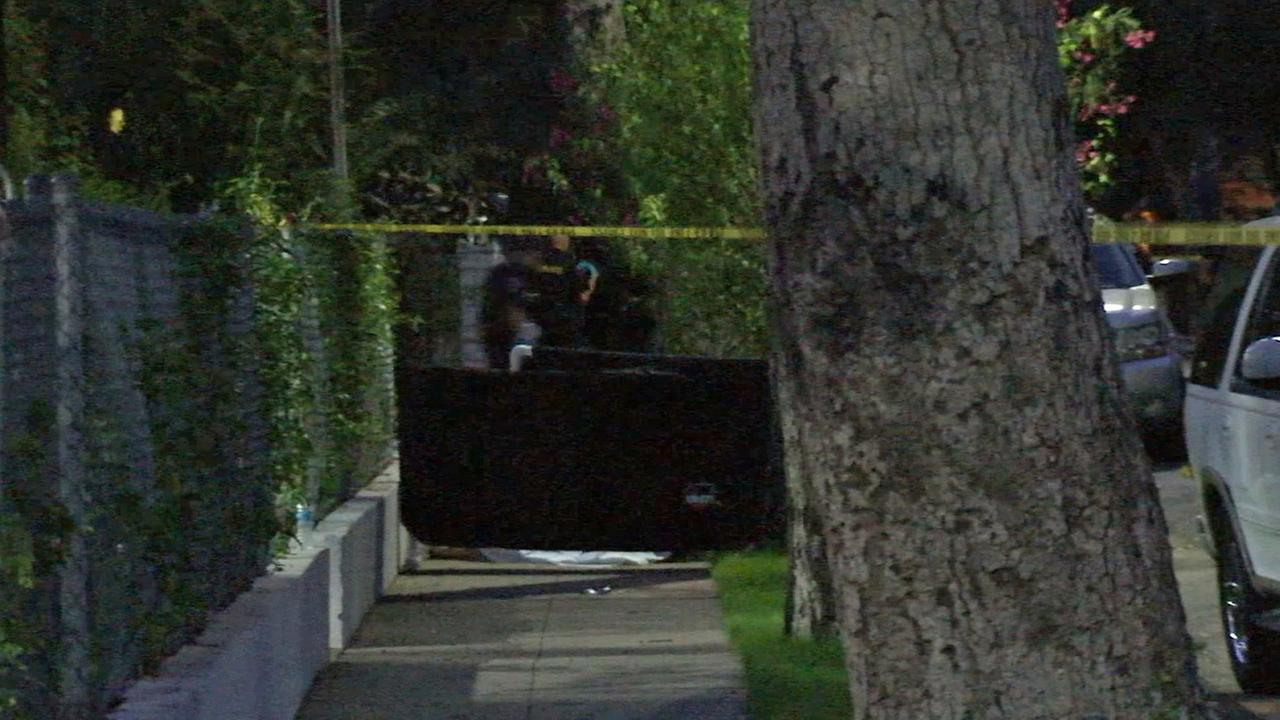 Authorities investigate a shooting that left three people dead in Pasadena on Saturday, July 12, 2014.