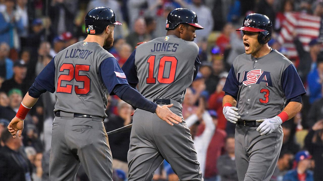 The U.S. teams Ian Kinsler celebrates a home run with Jonathan Lucroy and Adam Jones in the final against Puerto Rico of the World Baseball Classic at Dodger Stadium on Wednesday.