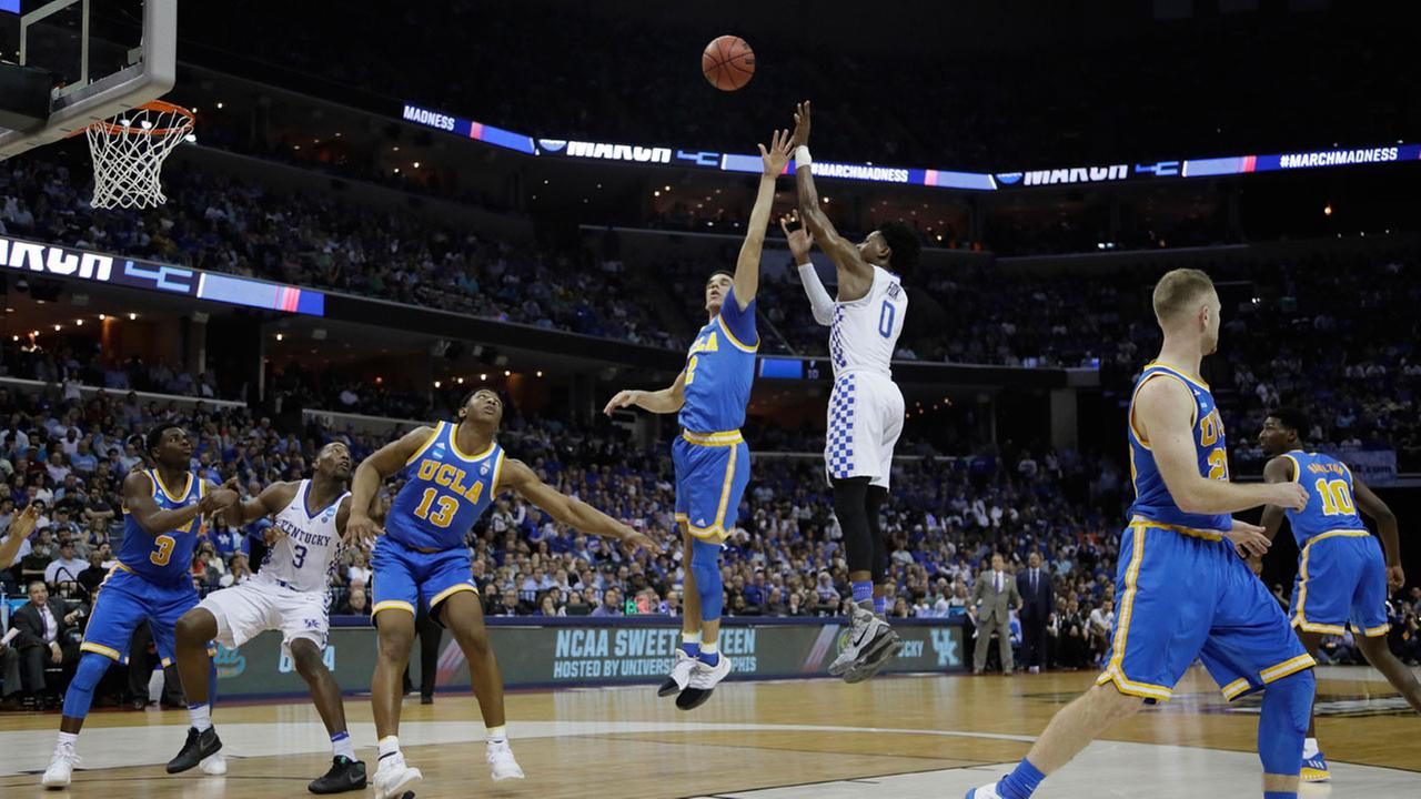 Kentucky guard DeAaron Fox shoots against UCLA in the first half of an NCAA college basketball tournament South Regional semifinal game Friday, March 24, 2017, in Memphis, Tenn.
